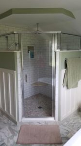 Home Contractor Concordville PA - Corner shower with custom tile and wainscoating.